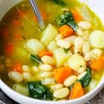 Bean Soup with spinach and pesto from pressure cooker served in a bowl