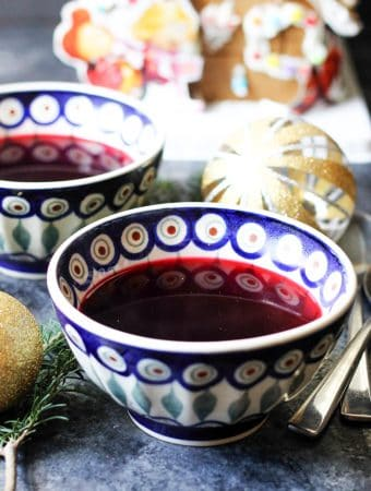 Borscht in traditional Polish bowls and Christmas decorations