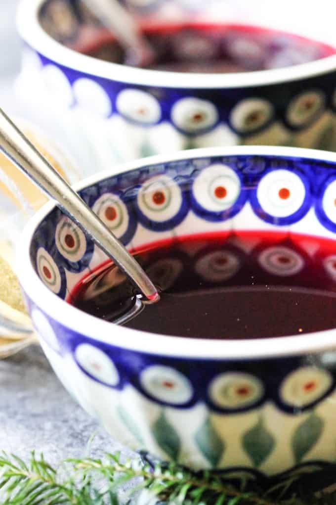 Barszcz czerwony in a bowl with spoon