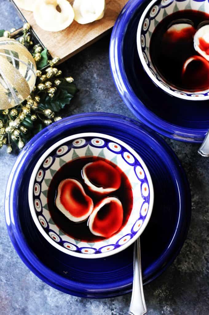 Mushroom Pierogi Uszka with Borscht in blue bowls
