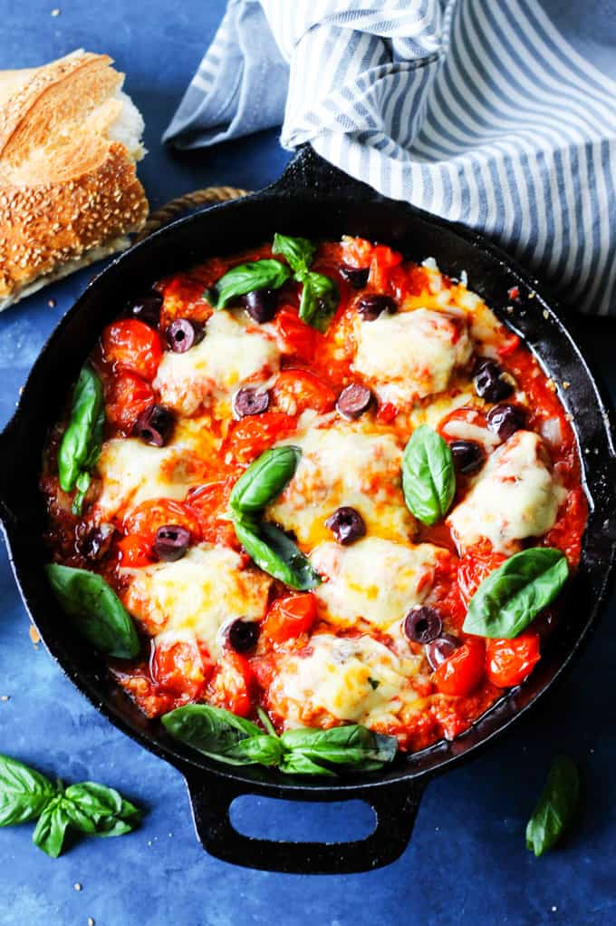 Veal Involtini with basil cheese and peppers in tomato olive sauce in a skillet
