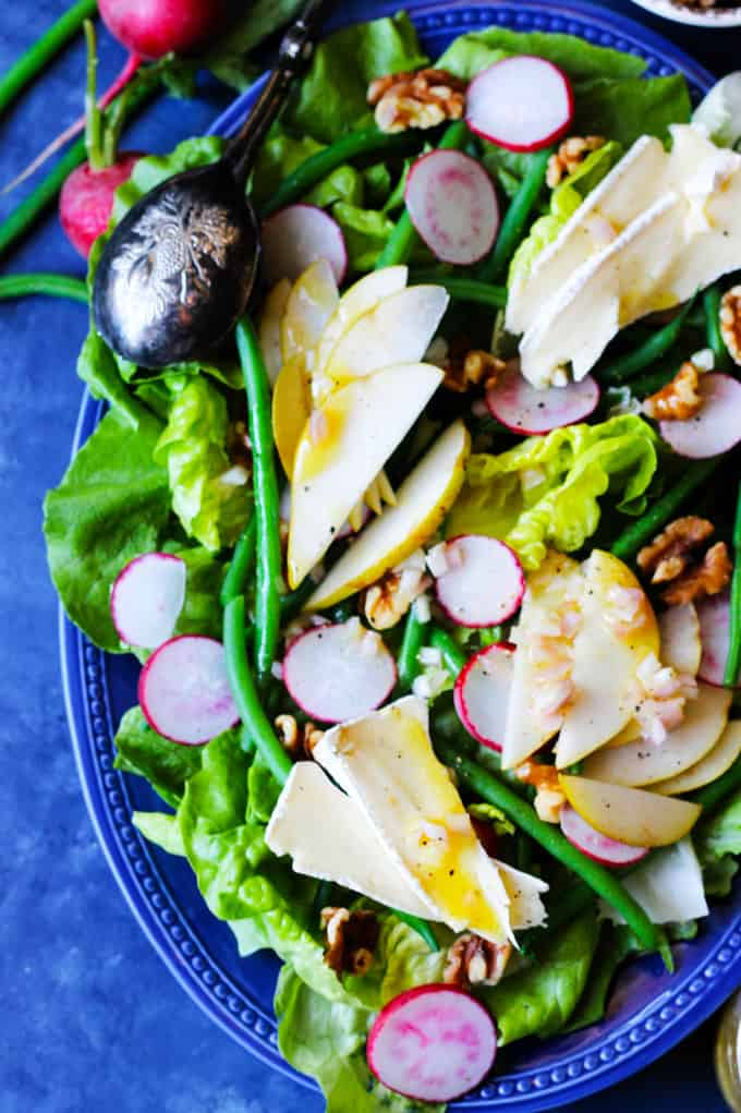 French Salad with Brie and Pears on a blue serving plate