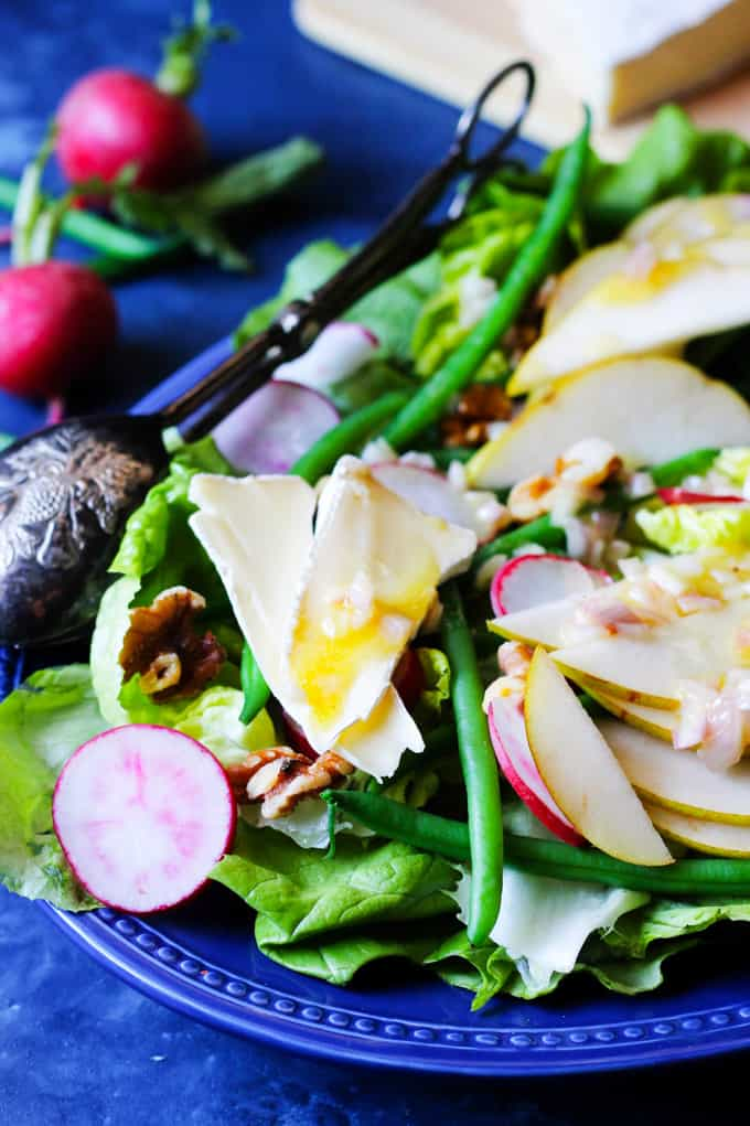 Close up of the french salad with brie, pears, radishes and beans