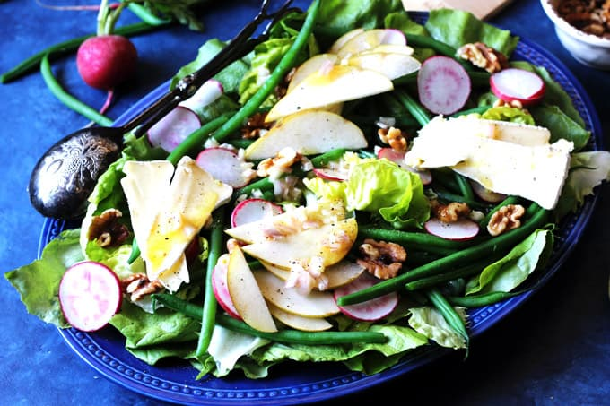 French salad on a blue serving plate