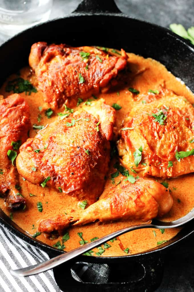 Chicken Paprikash in a skillet with a spoon.