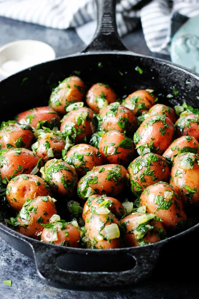 Parsley potatoes in cast iron skillet