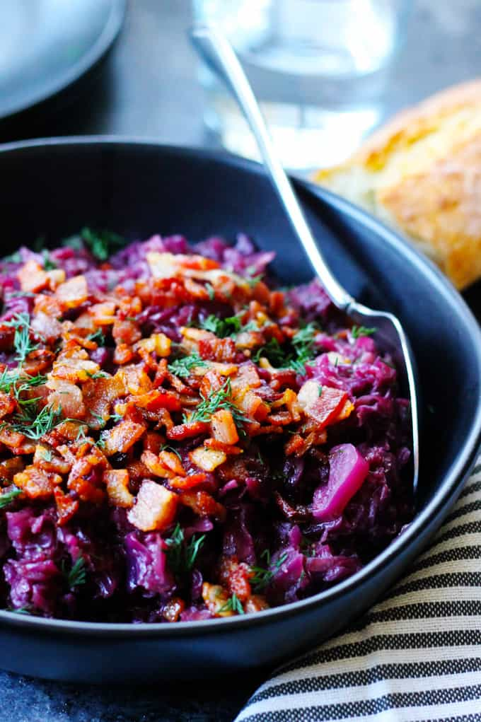 German Braised Red Cabbage in a black bowl with spoon