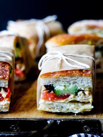 Pan Bagnat (French Sandwich) on a cutting board