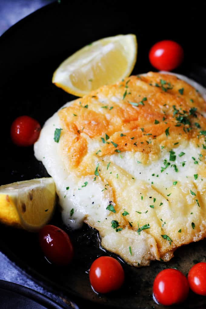 Greek Saganaki on a plate with lemons