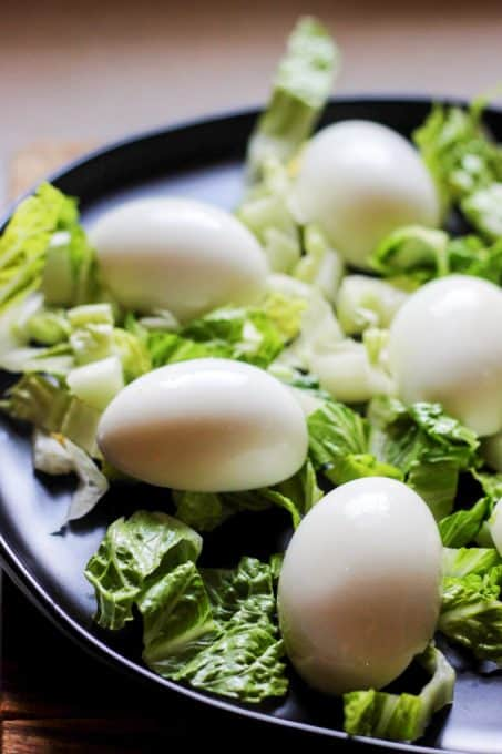 Plating eggs on a bed of lettuce for Eggs Mayonnaise