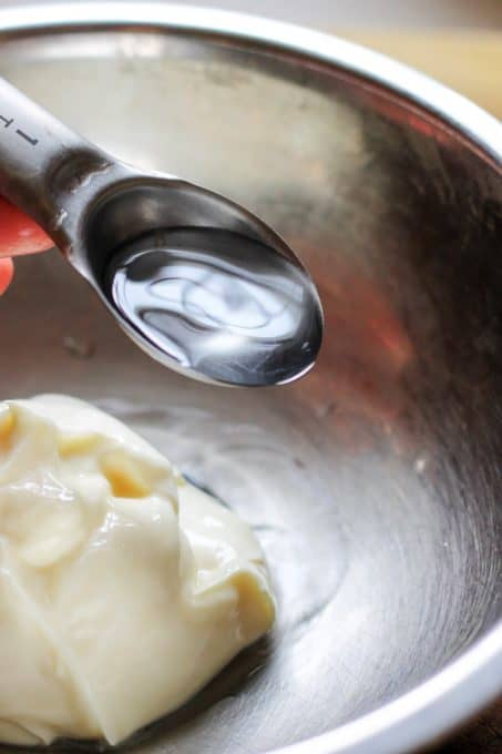 Adding water to mayonnaise to prepare sauce for Eggs Mayonnaise