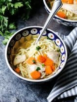 Rosol Polish Chicken Soup in a pretty bowl with a spoon