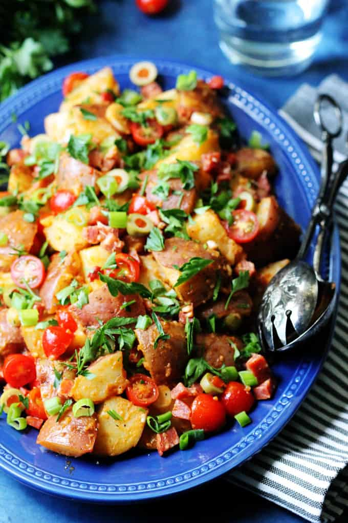 Smoky Spanish Potato Salad with Roasted Peppers and Chorizo on a serving plate