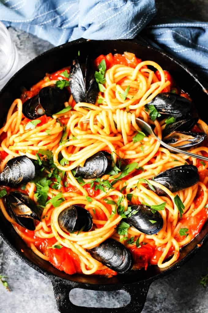 Mussels Pasta with Tomato Sauce in a skillet