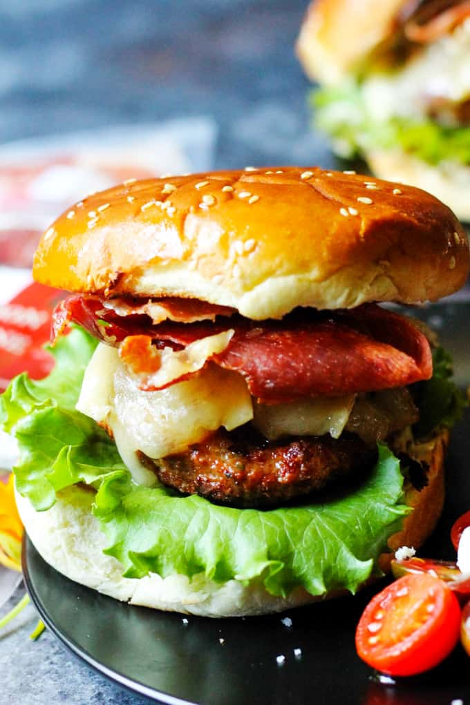 Turkey burger with brie cheese and Bayonne ham on a plate