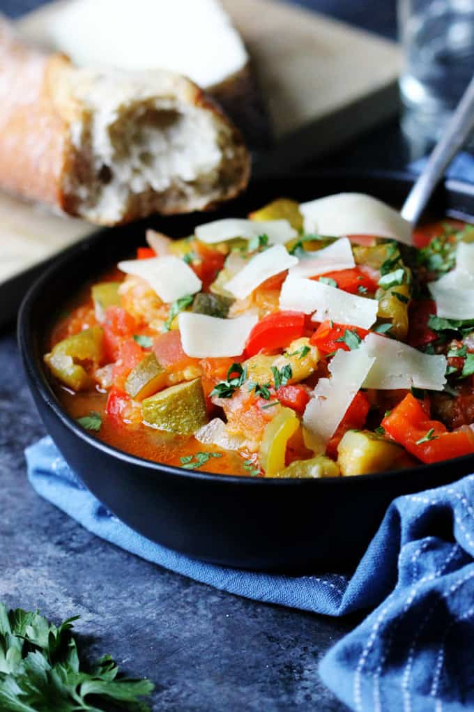 Spanish Ratatouille in a black bowl with spoon