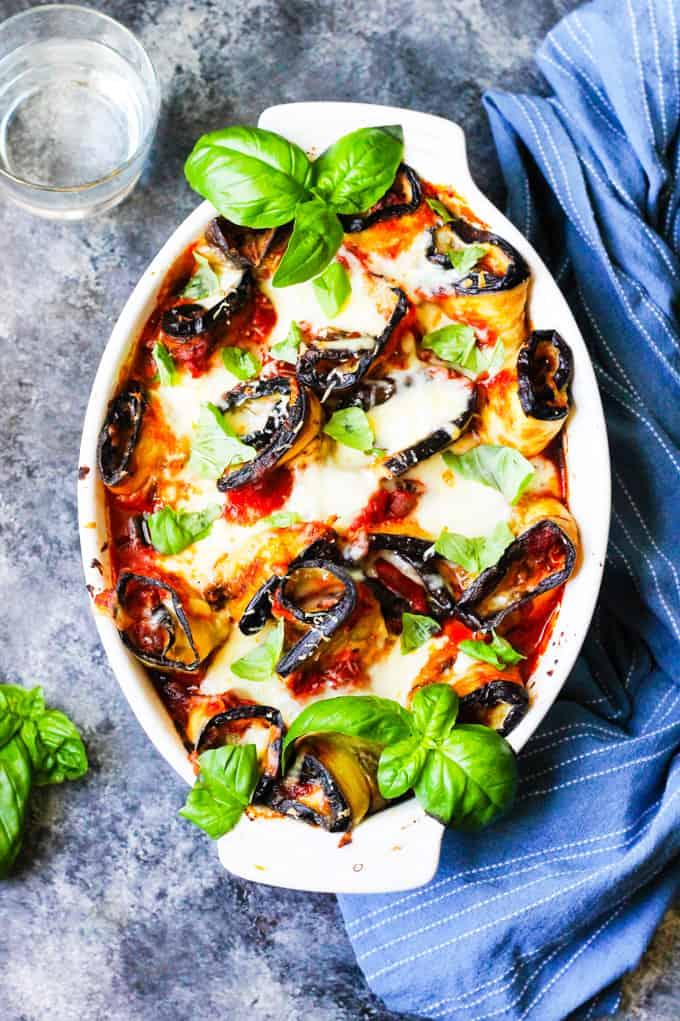 Eggplant Rollatini Parmigiaina in white casserole dish