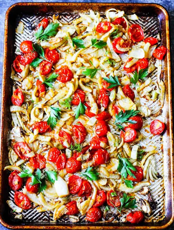 Roasted fennel and tomatoes on a baking sheet