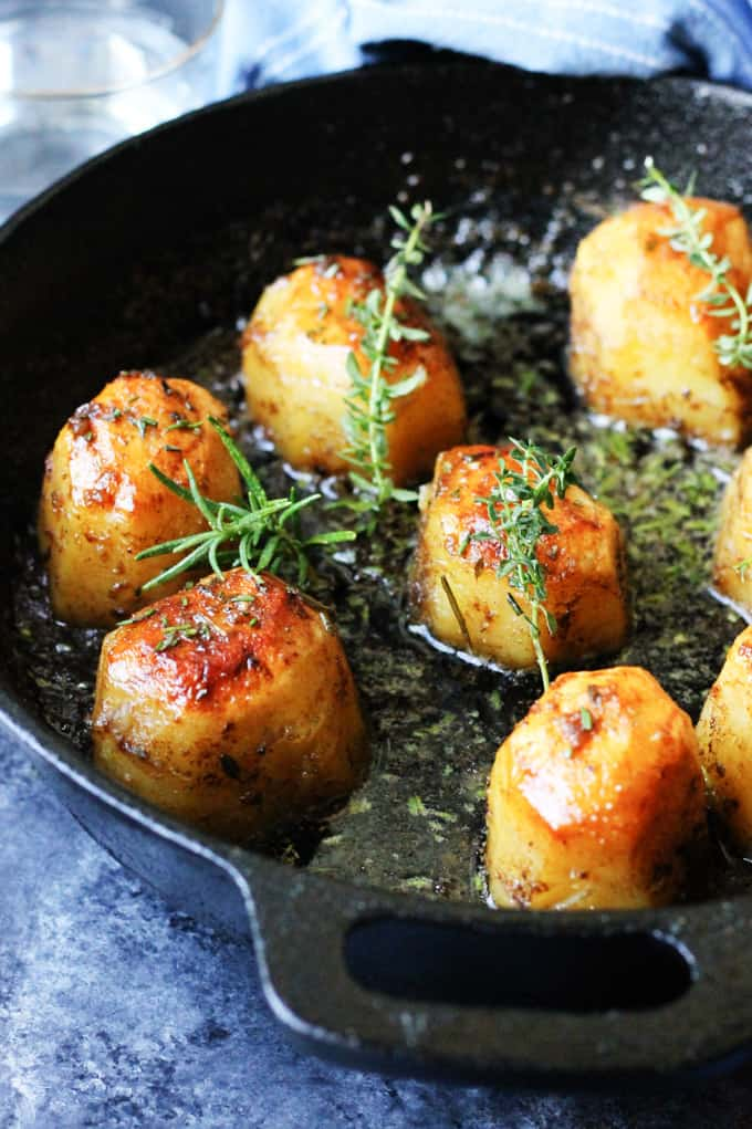 Potatoes Fondant in a skillet with herbs