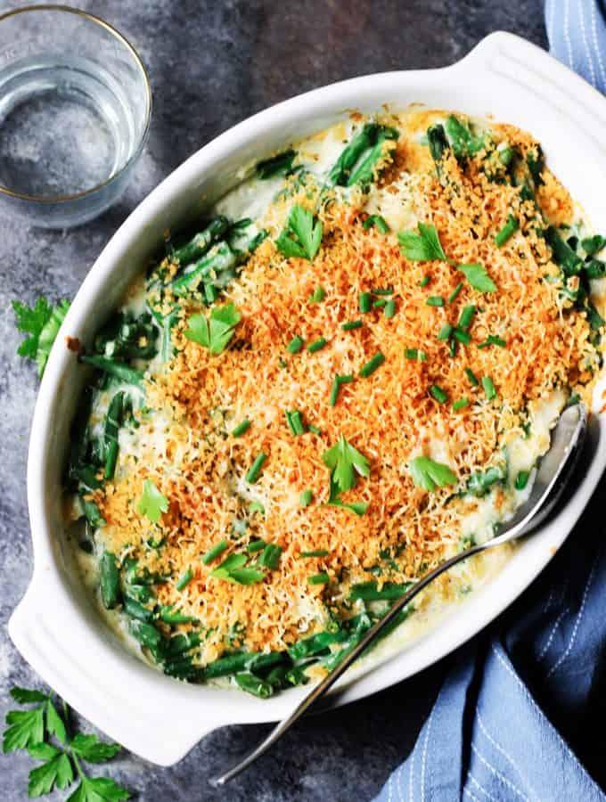 Green bean casserole in white baking dish