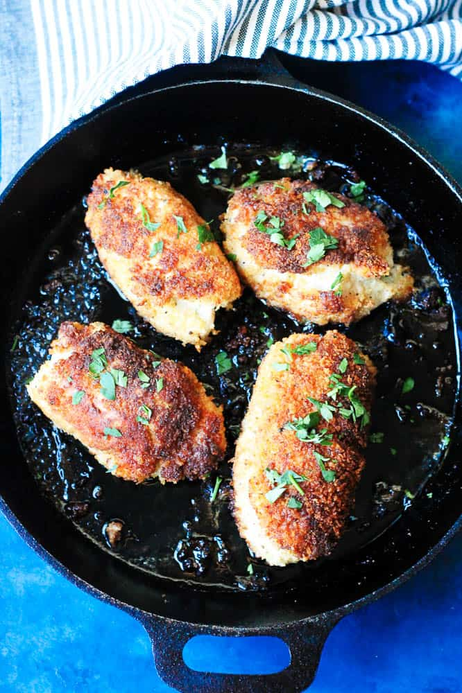 Chicken kiev in a black cast iron skillet