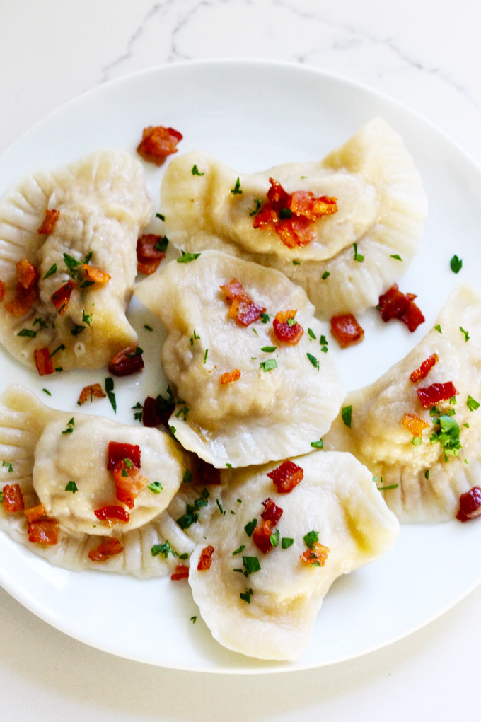 A white plate filled with Polish Meat Pierogi