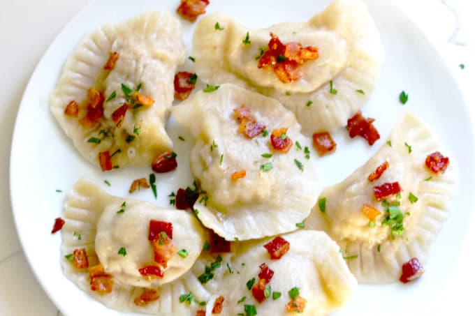 White plate filled with pierogi