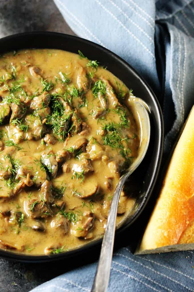 Close up of a black bowl with creamy beef stroganoff